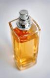 Botella de perfume amarilla Imagenes de archivo