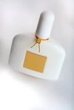 Botella de perfume blanca Foto de archivo libre de regalías