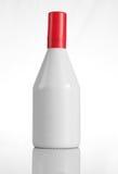 Botella de perfume blanca con el casquillo rojo para las maquetas Imagen de archivo libre de regalías