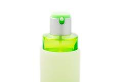 Botella de perfume verde aislada Fotografía de archivo libre de regalías
