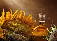 Botella de petróleo con los girasoles Imagenes de archivo