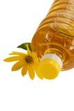 Botella de petróleo y de flor de girasol aislados imágenes de archivo libres de regalías