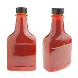 Botella de salsa de tomate en blanco Foto de archivo libre de regalías