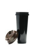 Botella de termo negra con la tapa abierta en el fondo blanco Imagen de archivo
