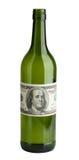 Botella de vino con las cuentas de un dólar Imagen de archivo libre de regalías