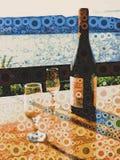 Botella de vino y de vidrios Imagen de archivo libre de regalías