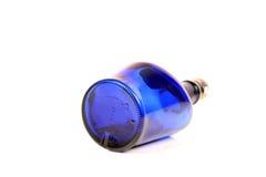 Botella de whisky azul Foto de archivo libre de regalías