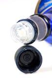 Botella de whisky azul Imágenes de archivo libres de regalías