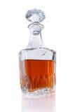 Botella de whisky de Borbón en un fondo blanco Fotos de archivo