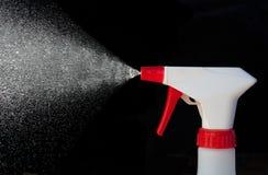 Botella del aerosol en la acción Imagen de archivo