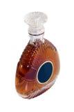 Botella del brandy aislada en blanco Fotografía de archivo libre de regalías