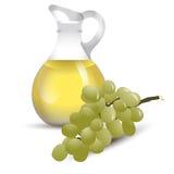Botella del vinagre con la uva Imagen de archivo libre de regalías