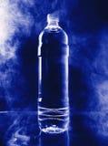 Botella en un ambiente del humo Foto de archivo libre de regalías