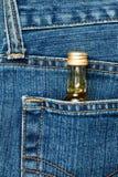 Botella en un bolsillo Foto de archivo