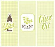 Botella, etiqueta y etiquetas engomadas de la marca del aceite de oliva con los modelos inconsútiles Imagen de archivo libre de regalías