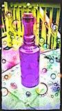 Botella púrpura foto de archivo libre de regalías