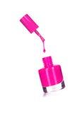 Botella púrpura del esmalte de uñas con el chapoteo Foto de archivo