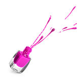 Botella púrpura del esmalte de uñas con el chapoteo Imagen de archivo