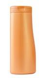 Botella plástica anaranjada Imágenes de archivo libres de regalías
