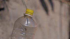 Botella plástica colgante foto de archivo libre de regalías