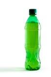 Botella plástica verde con una bebida Foto de archivo