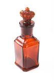 Botella retra marrón de cristal con la corona del tapón Fotografía de archivo