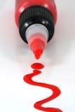 Botella roja de la pintura Fotos de archivo libres de regalías