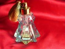 Botella roja del satén y de perfume Imagen de archivo libre de regalías