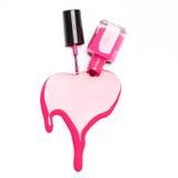 Botella rosada del esmalte de uñas con las salpicaduras aisladas en el fondo blanco Fotografía de archivo