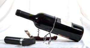 Botella, sacacorchos y vacío Fotografía de archivo libre de regalías