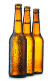Botella tres con la cerveza imagen de archivo