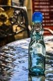 Botella vacía del Codd-cuello en una tabla fotografía de archivo libre de regalías