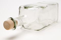 Botella vacía reclinada Foto de archivo libre de regalías