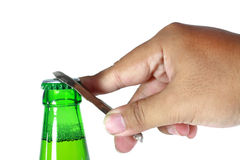 Botella verde abierta de la mano Fotos de archivo libres de regalías