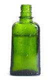 Botella verde con un petróleo orgánico Foto de archivo