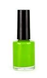 Botella verde del esmalte de uñas en el fondo blanco Fotografía de archivo