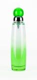Botella verde del parfume aislada Imagenes de archivo