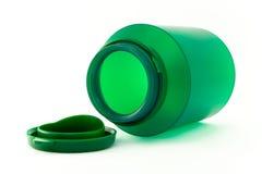 Botella verde plástica verdadera. Foto de archivo