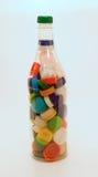 Botella y casquillos plásticos Fotografía de archivo libre de regalías