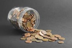 Botella y dinero Fotos de archivo libres de regalías
