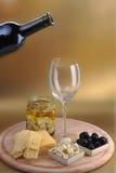 Botella y queso de vino Imagen de archivo libre de regalías