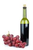 Botella y uvas de vino Imagenes de archivo