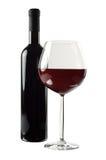 Botella y vidrio de vino rojo Foto de archivo libre de regalías