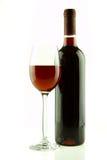 Botella y vidrio de vino rojo aislados Fotografía de archivo libre de regalías