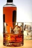 Botella y vidrios del licor Foto de archivo libre de regalías