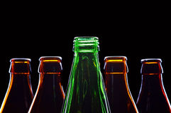 Botellas aisladas en negro fotos de archivo