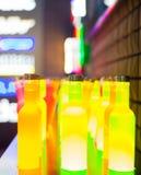 Botellas amarillas Imagenes de archivo