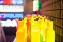 Botellas amarillas Imágenes de archivo libres de regalías