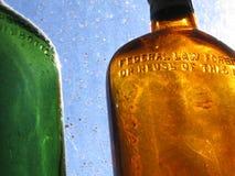 Botellas antiguas en la sol Foto de archivo libre de regalías