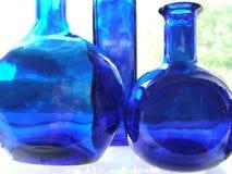 Botellas azules fotografía de archivo libre de regalías